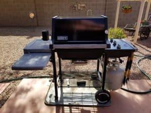 17 year old like new black Weber gas grill in backyard