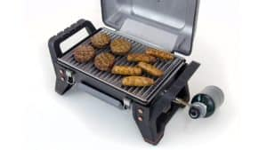 Photo of powerful portable grill with sausages and hamburger patties